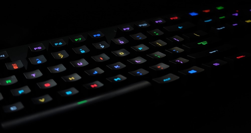 rgb keyboard in darkness with keys having different colors