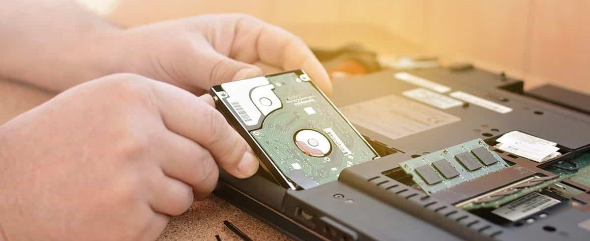 man upgrading his laptop